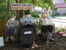 Scarecrows waiting in departures